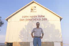 Farmer standing in front of corn barn Royalty Free Stock Photo