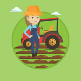 Farmer standing with tractor on background. Stock Photo