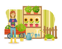 Farmer, stands near the department with plants and garden products. Royalty Free Stock Photography
