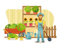 Farmer, stands near the department with plants and garden products. Royalty Free Stock Photos