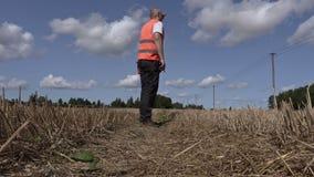 Farmer on straw field in summer stock video