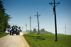 Farmer on Suburb Road Royalty Free Stock Image