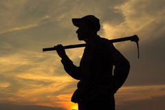 Farmer and sunset Royalty Free Stock Images