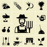 Farmer surrounded by farming themed icons Royalty Free Stock Photo