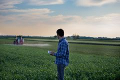 Farmer with tablet and tractor royalty free stock image