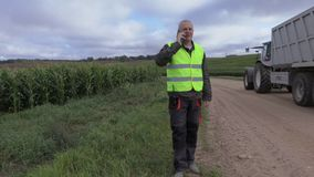 Farmer talking on smart phone near stock footage