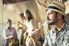 Farmer taste a glass of white wine. In his farmhouse Royalty Free Stock Images