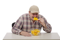 Farmer tastes a yellow watermelon. Farmer in a baseball cap tastes a yellow watermelon Royalty Free Stock Photo