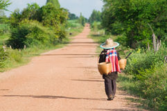 Farmer in Thailand walking home Royalty Free Stock Photography