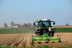Farmer Tilling Field Stock Image