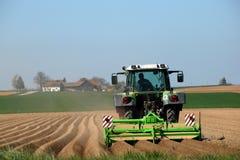Farmer Tilling Field stock image