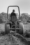 Farmer Tilling Field Harvesting Potatoes Royalty Free Stock Photo