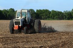 Farmer Tilling The Field Royalty Free Stock Photos