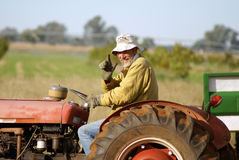 Farmer on tractor royalty free stock photography