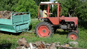 Farmer tractor firewood stock footage
