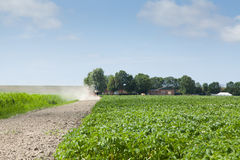 Farmer with tractor and plow in field Stock Photography