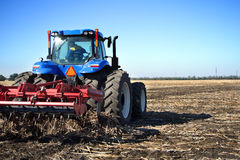 Farmer on a tractor plowed field Royalty Free Stock Photography