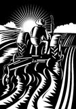 Farmer on tractor plowing field. Vector illustration of a Farmer on tractor plowing field  in woodcut retro style Stock Image