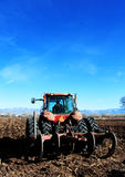 Farmer in Tractor Plowing Field. Tractor plowing a field preparing for planting Stock Photo