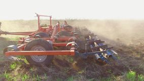 Farmer in tractor plows Russia steadicam motion agriculture soil the ground preparing land with seedbed cultivator. Farmer in tractor plows Russia steadicam stock footage