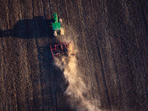 Farmer in tractor preparing land with cultivator Stock Photography