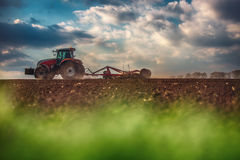 Farmer in tractor preparing land with seedbed cultivator Royalty Free Stock Images