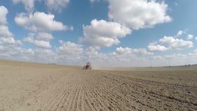Farmer in tractor preparing land stock video