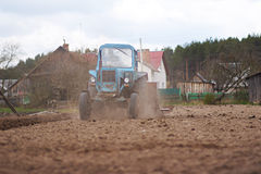 Farmer in tractor preparing Stock Images