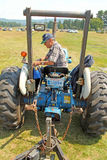 Farmer on tractor pulling wagon at air show Berkshires MA Stock Photos
