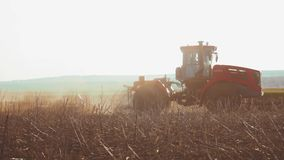 Farmer in tractor Russia agriculture soil ground preparing land with seedbed cultivator as part of pre seeding. Farmer in tractor Russia agriculture soil ground stock video footage