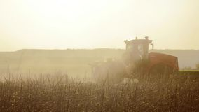Farmer in tractor Russia agriculture soil ground preparing land with seedbed cultivator as part of pre seeding. Farmer in tractor Russia agriculture soil ground stock footage