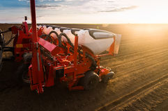 Farmer with tractor seeding - sowing crops at agricultural field. S in spring Stock Image