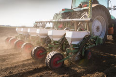 Farmer with tractor seeding - sowing soy crops at agricultural f Royalty Free Stock Photography