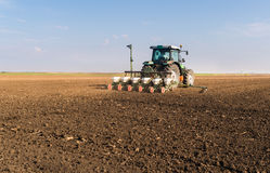 Farmer with tractor seeding - soy sowing crops at agricultural f. Ields in spring Stock Photography