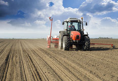 Farmer in tractor sowing crops royalty free stock photography