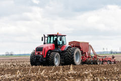 Farmer tractor working in the field. Spring time for sowing. Royalty Free Stock Photo