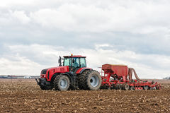 Farmer tractor working in the field. Spring time for sowing. Royalty Free Stock Images