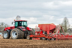 Farmer tractor working in the field. Spring time for sowing. Royalty Free Stock Photos