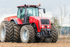 Farmer tractor working in the field. Spring time for sowing. Royalty Free Stock Photography