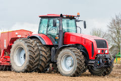 Farmer tractor working in the field. Spring time for sowing. Stock Image