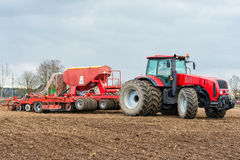 Farmer tractor working in the field. Spring time for sowing. Planting crops Stock Images