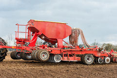 Farmer tractor working in the field. Spring time for sowing. Planting crops Stock Photos