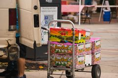 A farmer unloads his fruit that he will sell at today`s farmer`s market in this small New Jersey town stock image