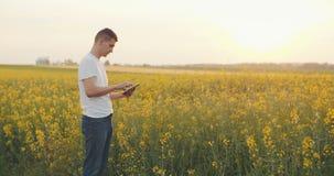 Farmer using Digital Tablet Computer on field stock footage