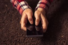 Farmer using smartphone stock images