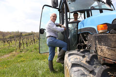Farmer in vineyard with tractor Royalty Free Stock Photo