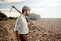 Farmer walking through the fields Stock Photo
