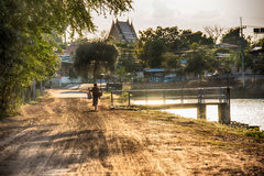 Farmer walking home after the harvest is completed Royalty Free Stock Image
