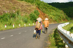 Farmer walking on road to coming home Stock Photography