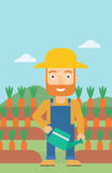 Farmer with watering can. A hipster man with the beard holding a watering can on the background of carrots growing on field vector flat design illustration Royalty Free Stock Image